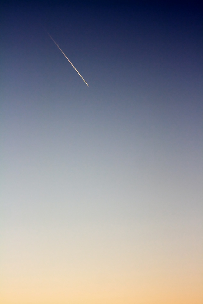 Sky at dusk with plane trail